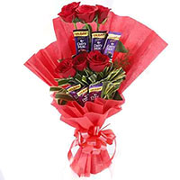 Place order to send 16 Pcs Ferrero Rocher and 24 Red White Roses Bouquet Mumbai