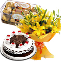 Send Anniversary Gifts to Mumbai Colaba. Send 12 Yellow Lily, 1/2 Kg Black Forest Cake, 16 Pcs Ferrero Rocher Chocolates to Mumbai