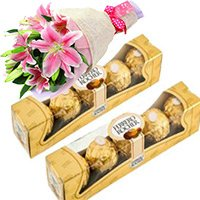 Send Gifts to Bhusaval. Order Online Ferrero Rocher Chocolates 10 Pieces with 2 Lily Stem Bhusaval