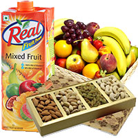 Online Christmas Gifts in Mumbai encircled with 1 Kg Real Juice with 2 Kg Fresh Fruits Basket and 1 Kg Mix Dry Fruits to Mumbai