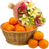 Send Bhaidooj Gifts to Mumbai including Pink Yellow Lily Flower Bouquet with 4 Flower Stems with 18 pcs Fresh Orange