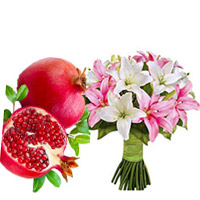 Bhaidooj Gifts Delivery to Mumbai be composed of 1 Kg Fresh Promegranate with Pink White Lily Bouquet 6 Stems
