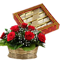 Friendship Day Gift Delivery in Mumbai. Send 500 gm Kaju Katli with 12 Red Roses Basket