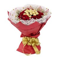 Online Gift Delivery of 16 Pcs Ferrero Rocher Chocolate encircled with 20 Red Roses