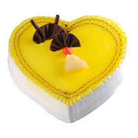 Order Cake Online Mumbai Midnight Delivery that includes 3 Kg Heart Shape Pineapple Cake